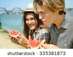 happy young couple eating... | Shutterstock . vector #335381873