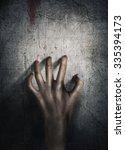 horror scene. hand on wall... | Shutterstock . vector #335394173