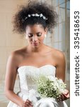 emotional curly brunette bride... | Shutterstock . vector #335418653
