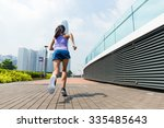 the back view of woman running   Shutterstock . vector #335485643