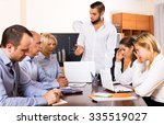young male boss and stressed co ... | Shutterstock . vector #335519027
