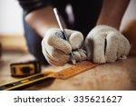 close up of craftsman hands in...   Shutterstock . vector #335621627