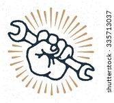 vector spanner in hand emblem ... | Shutterstock .eps vector #335713037
