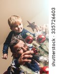 father and son are decorating... | Shutterstock . vector #335726603