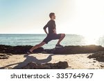 young male working out on beach ... | Shutterstock . vector #335764967