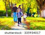 happy young girl running in... | Shutterstock . vector #335934017