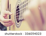 close up image of man playing... | Shutterstock . vector #336054023