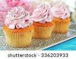tasty cupcakes on plate  on...