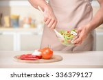 salad is ready. healthy young... | Shutterstock . vector #336379127