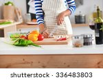 young woman cutting vegetables... | Shutterstock . vector #336483803