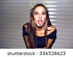 Young Woman Having Fun  Showin...