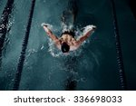 Sportsman Swims In A Swimming...