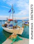Greek Fishing Boat Mooring In...