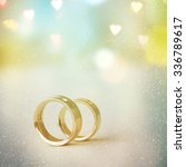two golden wedding rings | Shutterstock . vector #336789617