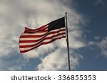 american flag flying against a... | Shutterstock . vector #336855353