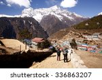 Small photo of NAMCHE BAZAAR,NEPAL-MARCH 2014: Unidentified trekkers descending to Namche Bazaar after doing their altitude acclimatization to the top of Syangboche at 3,841m above sea level on 29 March 2014.