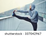 Male Runner Doing Stretching...