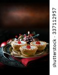 Small photo of Thanksgiving or Christmas festive iced pastry mince pies on antique pewter plate against a rustic background with accommodation for copy space.