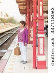 Small photo of Mature vital elderly woman at Hua Hin train station. travel on holiday in vintage tone.