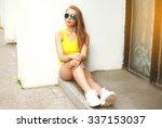 beautiful young woman wearing a ... | Shutterstock . vector #337153037