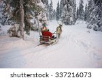 Winter Reindeer Sled Racing In...