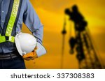 engineer holding a white helmet ...   Shutterstock . vector #337308383