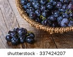 bunch of black grapes in a... | Shutterstock . vector #337424207