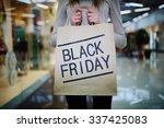 young shopper showing black