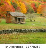 An old cabin during fall of the year in Virginia. - stock photo