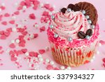pink cupcake with frosting and... | Shutterstock . vector #337934327
