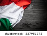flag of italy on dark wood... | Shutterstock . vector #337951373