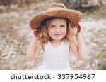 happy little girl wearing a hat ... | Shutterstock . vector #337954967