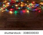 christmas lights on wood... | Shutterstock . vector #338033033