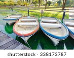 rowboats tied to a pier | Shutterstock . vector #338173787