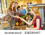 smiling woman paying with her... | Shutterstock . vector #338285447