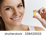 vitamins. close up of happy... | Shutterstock . vector #338420033