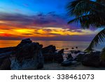 sunset through the palm trees... | Shutterstock . vector #338461073