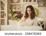 young woman drinking tea in the ... | Shutterstock . vector #338478383