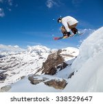 jumping snowboarder keeps one... | Shutterstock . vector #338529647