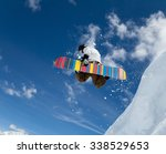jumping snowboarder keeps one... | Shutterstock . vector #338529653