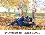 parents sit under a tree  and...   Shutterstock . vector #338536913