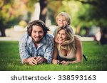young beautiful happy family at ... | Shutterstock . vector #338593163