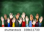 hands raised togetherness... | Shutterstock . vector #338611733