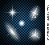 set of glowing light stars with ... | Shutterstock .eps vector #338687993