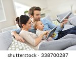 family with baby in sofa... | Shutterstock . vector #338700287