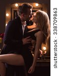 Small photo of Vertical image of elegant couple having a quickie
