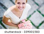 Smiling Bride Holding Big...