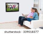 mature couple sitting on sofa... | Shutterstock . vector #339018377