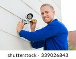 smiling young technician... | Shutterstock . vector #339026843