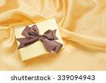 gift box on gold fabric...   Shutterstock . vector #339094943
